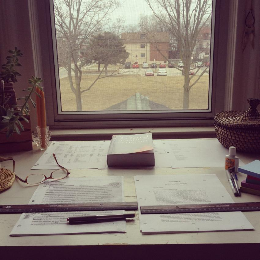 Proofreading at my desk by the window.